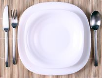 A white plate with cutlery Stock Images