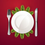White plate with cutlery Royalty Free Stock Photos
