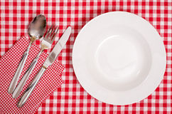 White plate with cutlery Royalty Free Stock Photo