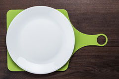 White plate and cutting board Stock Images