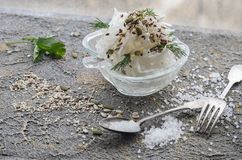 White plate with daikon cutlery large Salt and seeds Royalty Free Stock Photography