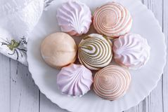 Marshmallows of different varieties on a plate. On a white plate is delicious marshmallows of different types. The view from the top royalty free stock images