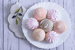 Marshmallows of different varieties on a plate. On a white plate is delicious marshmallows of different types. The view from the top stock images