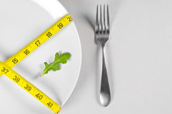 White Plate and Diet. With nutrition and hunger Stock Photos
