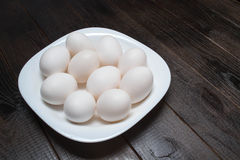 White plate with eggs. White dish with eggs on the table Stock Photos