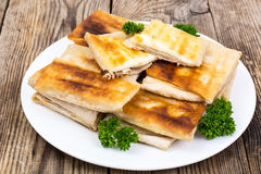 White plate with envelopes of thin Armenian bread lavash fried stock photos