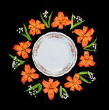 White plate and flowers Royalty Free Stock Images