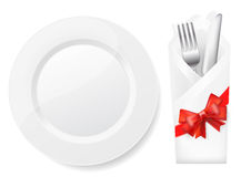 White plate,fork and knife Royalty Free Stock Photos