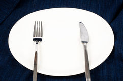 White plate with fork and knife Royalty Free Stock Photo