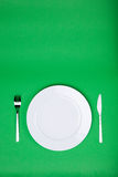 White plate, fork and knife Royalty Free Stock Images