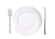 White plate, fork and knife isolated on white Royalty Free Stock Photo