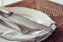 White plate, fork and knife Stock Photos