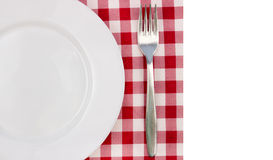 White plate and fork Stock Images