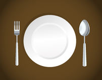 White plate,fork and spoon Stock Photography
