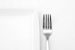 White plate with fork Royalty Free Stock Photos