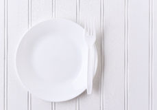 White Plate and Fork Royalty Free Stock Images