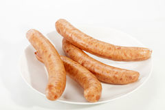 White Plate with Four Cheesy Russian Sausages Stock Photo
