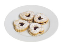 White plate with four heart shaped cookies Royalty Free Stock Photos