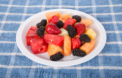 White Plate of Fresh Cut Fruit and Berries Stock Image