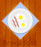White Plate with Fried Eggs on Kitchen Napkin at Wooden Boards B Royalty Free Stock Images
