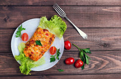 white plate glass portion of the baked cod fish Royalty Free Stock Photography