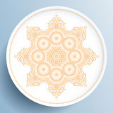 White plate with gold floral ornament. On light blue background Royalty Free Stock Photo