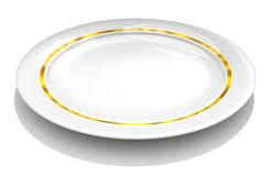 White plate with gold rim Stock Photo