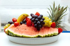White plate grapes arrangement fruits berries breakfast buffet banana watermelon strawberry hotel breakfast. Arrangement of fruits and berries on the buffet or stock images
