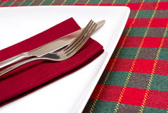 White plate with green and red tablecloth Royalty Free Stock Image