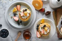 A white plate with homemade pancakes. top view Concept of Cooking ingredients and method and plating. A white plate with homemade pancakes. top view Concept of royalty free stock image