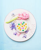 White plate with hyacinth flower and spring bake cake on light blue on light blue shabby  rustic background, top view. Royalty Free Stock Images