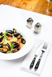 White plate of italian pasta with mussels, cherry tomato  and he Stock Image