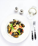 White plate of italian pasta with mussels, cherry tomato  and he Royalty Free Stock Images