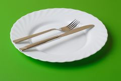 White plate, knife, and fork Royalty Free Stock Photography