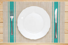 White plate with knife and fork stock photography