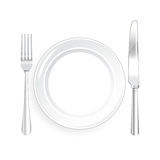 White Plate and Knife and Fork with on White Background Royalty Free Stock Photos