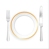 White Plate Knife and Fork on White Background Royalty Free Stock Image