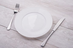 White plate, knife and fork Stock Photo