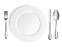 White plate with knife,spoon Stock Images