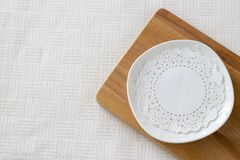 White plate Light background Selective focus Copy space. Stock Images