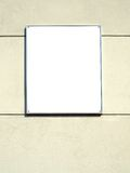 White plate in a metal frame Stock Photos