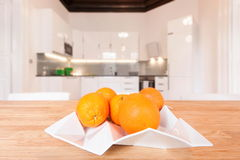 White plate with oranges. White cubist plate with oranges in modern kitchen Stock Image