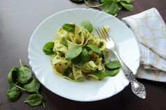 White plate with pasta with spinach Stock Image