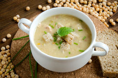 White plate pea soup greenery Royalty Free Stock Photos