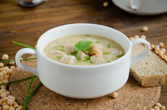 White plate pea soup greenery round board Royalty Free Stock Images