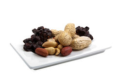 White plate with peanut products Stock Images