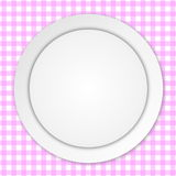 White plate on pink tablecloth Royalty Free Stock Photos