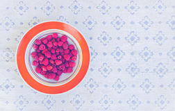 White plate of raspberries. On a rustic table Stock Photo