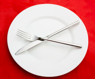 White plate on red Stock Photo
