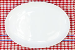 White plate on red checked. Tablecloth Stock Photography
